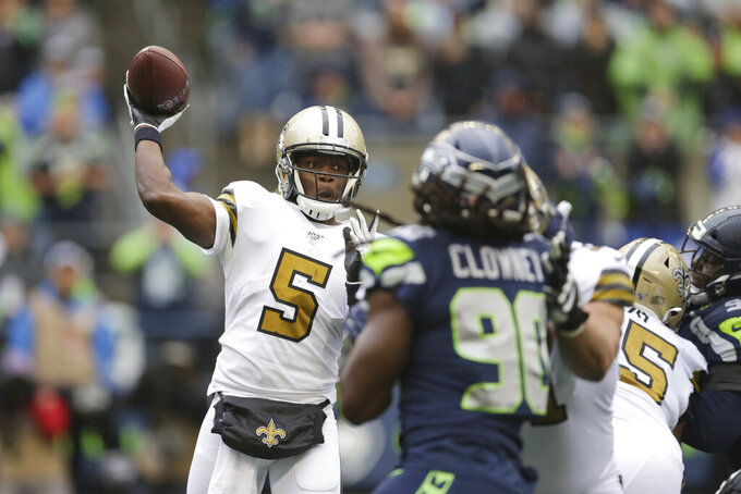 New Orleans Saints quarterback Teddy Bridgewater (5) throws against the Seattle Seahawks during the first half of an NFL football game Sunday, Sept. 22, 2019, in Seattle. (AP Photo/Scott Eklund)