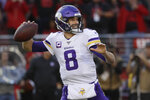 FILE - In this Jan. 11, 2020, file photo, Minnesota Vikings quarterback Kirk Cousins (8) passes against the San Francisco 49ers during the first half of an NFL divisional playoff football game in Santa Clara, Calif. Cousins discussed his contract extension on a video conference call with reporters, Tuesday, April 14, 2020. (AP Photo/Marcio Jose Sanchez, File)
