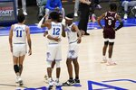 Memphis' Lester Quinones (11), DeAndre Williams (12), D.J. Jeffries, rear, and Landers Nolley II, right, celebrate in the closing seconds of their NCAA college basketball championship game in the NIT as Mississippi State guard Deivon Smith (5) stands nearby, Sunday, March 28, 2021, in Frisco, Texas. (AP Photo/Tony Gutierrez)