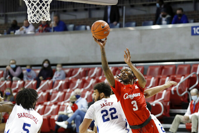 Houston guard DeJon Jarreau (3) takes a shot while SMU forward Isiah Jasey (22) defends during the first half of an NCAA college basketball game in Dallas, Sunday, Jan. 3, 2021. (AP Photo/Roger Steinman)