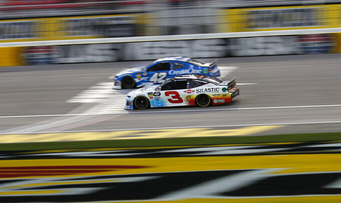Austin Dillon (3) and Kyle Larson (42) drive during qualifying for a NASCAR Cup Series auto race at the Las Vegas Motor Speedway, Friday, March 1, 2019, in Las Vegas. (AP Photo/John Locher)