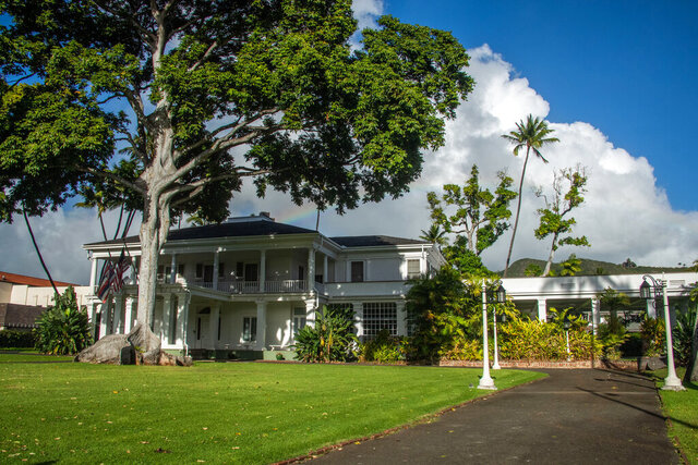 Washington Place, the longtime residence of Hawaii's Queen Liliuokalani and a dozen governors, is seen in Honolulu on Sunday, Jan, 24, 2020. Birthday plans for one of Hawaii's most esteemed houses have raised concerns over the proposed $53,000 cost while the state deals with significant economic problems stemming from the coronavirus pandemic. Democratic Gov. David Ige proposed the commemoration of Washington Place, the Honolulu Star-Advertiser reported Monday, Jan. 25, 2021. (Craig T. Kojima//Honolulu Star-Advertiser via AP)