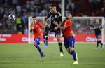 Argentina's Lautaro Martinez, center, is defended by Chile's Paulo Diaz during the first half of an international friendly soccer match Thursday, Sept. 5, 2019, in Los Angeles. (AP Photo/Marcio Jose Sanchez)