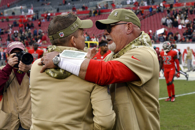 Tampa Bay Buccaneers head coach Bruce Arians, right, congratulates New Orleans Saints head coach Sean Payton after an NFL football game Sunday, Nov. 17, 2019, in Tampa, Fla. (AP Photo/Jason Behnken)