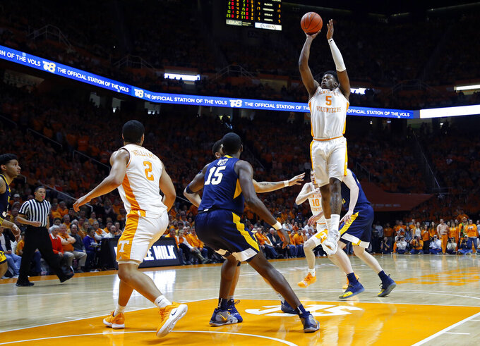Tennessee guard Admiral Schofield (5) shoots over West Virginia forward Lamont West (15) in the first half of an NCAA college basketball game Saturday, Jan. 26, 2019, in Knoxville, Tenn. (AP Photo/Wade Payne)