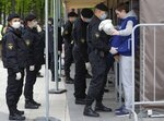 Belarus policemen wearing protective face masks check soccer fans at the entrance of the stadium prior to the Belarusian Cup final soccer match between BATE Borisov and Dynamo Brest in Minsk, Belarus, Sunday, May 24, 2020. BATE Borisov has won the Belarusian Cup with thousands of fans watching in a rare case of a soccer trophy being decided during the coronavirus pandemic. Belarus has not stopped holding public gatherings with spectators. (AP Photo/Sergei Grits)