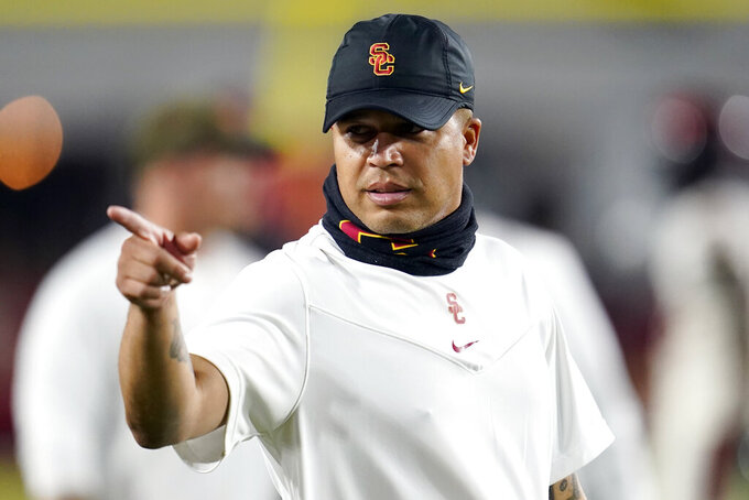 Southern California head coach Donte Williams signals before an NCAA college football game against Oregon State Saturday, Sept. 25, 2021, in Los Angeles. (AP Photo/Marcio Jose Sanchez)
