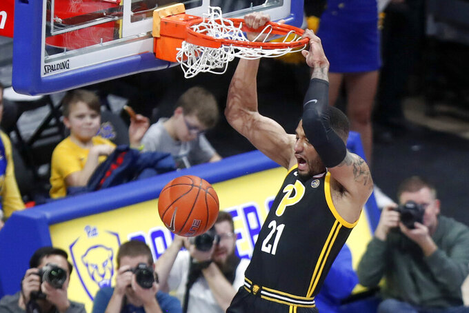 Pittsburgh's Terrell Brown dunks against Clemson during the first half of an NCAA college basketball game Wednesday, Feb. 12, 2020, in Pittsburgh. (AP Photo/Keith Srakocic)