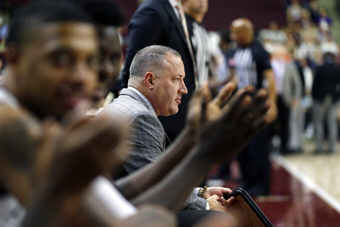 Texas A&M head coach Buzz Williams watches as his team is announced before the start of an NCAA college basketball game against Northwestern State on Wednesday, Nov. 6, 2019, in College Station, Texas. (AP Photo/Sam Craft)