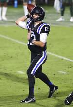 Duke quarterback Gunnar Holmberg (12) throws a pass against Charlotte during the first half of an NCAA college football game Saturday, Oct. 31, 2020, in Durham, N.C. (Jaylynn Nash/Pool Photo via AP)