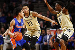 Vanderbilt forward Matthew Moyer (13) and guard Saben Lee (0) pressure Florida guard Tre Mann (1) during an NCAA college basketball game Saturday, Feb. 1, 2020, in Nashville, Tenn. (Wade Payne/The Tennessean via AP)