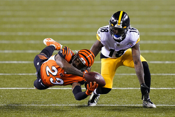 Cincinnati Bengals' Darius Phillips (23) breaks up a pass intended for Pittsburgh Steelers' Diontae Johnson (18) during the first half of an NFL football game, Monday, Dec. 21, 2020, in Cincinnati. (AP Photo/Bryan Woolston)