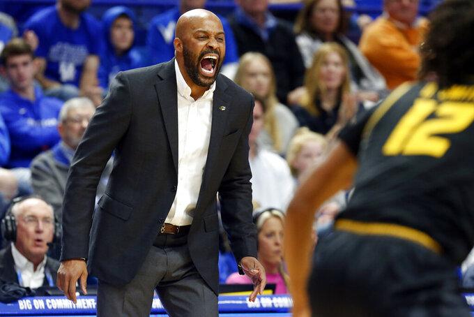 Missouri head coach Cuonzo Martin yells to his team during the first half of an NCAA college basketball game against Kentucky in Lexington, Ky., Saturday, Jan 4, 2020. (AP Photo/James Crisp)