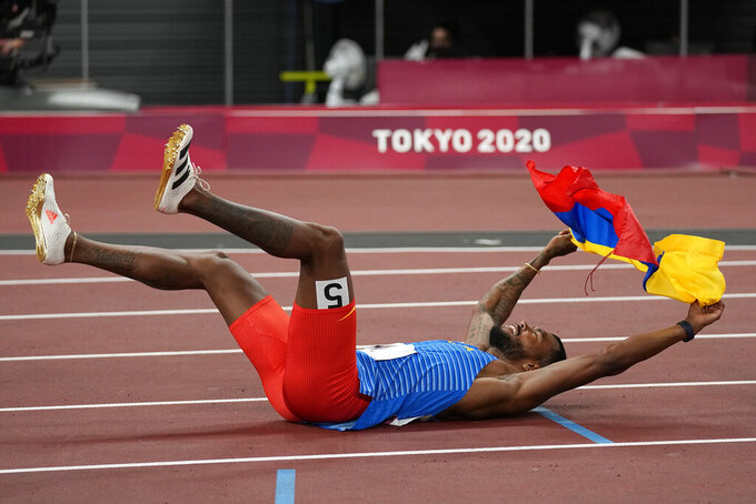Anthony Zambrano, of Colombia, reacts after his second place finish in the final of the men's 400-meters at the 2020 Summer Olympics, Thursday, Aug. 5, 2021, in Tokyo. (AP Photo/David J. Phillip)