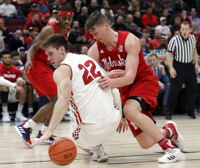 Wisconsin's Ethan Happ (22) and Nebraska's Tanner Borchardt battle for a loose ball during the second half of an NCAA college basketball game in the quarterfinals of the Big Ten Conference tournament, Friday, March 15, 2019, in Chicago. (AP Photo/Nam Y. Huh)