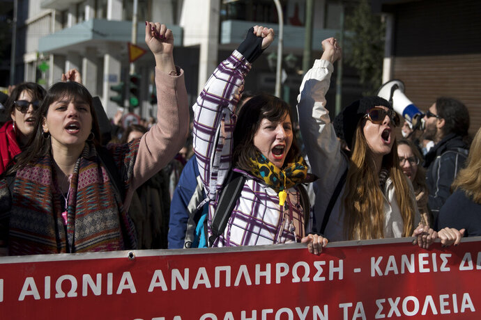 School teachers protest in central Athens, on Thursday, Jan. 17, 2019. Hundreds of striking Greek civil servants, mostly school teachers, are marching through central Athens to protest the proposed new hiring criteria for state school teachers. (AP Photo/Petros Giannakouris)
