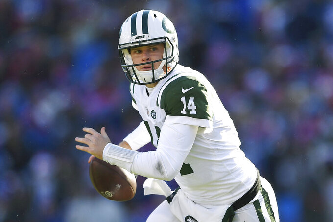 FILE - In this Dec. 9, 2018, file photo, New York Jets quarterback Sam Darnold rolls out during the first half of an NFL football game against the Buffalo Bills, in Orchard Park, N.Y.  Given the many variables that go into developing an elite quarterback, Pro Football Hall of Famer Jim Kelly can't even imagine assessing what to make of last year's group of five first-round draft picks as they enter their sophomore seasons. (AP Photo/Adrian Kraus, File)
