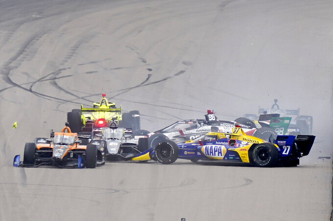 Several cars crash into each other before the start of the IndyCar auto race at World Wide Technology Raceway on Saturday, Aug. 29, 2020, in Madison, Ill. The accident caused several cars to be knocked out of the race before it officially started. (AP Photo/Jeff Roberson)