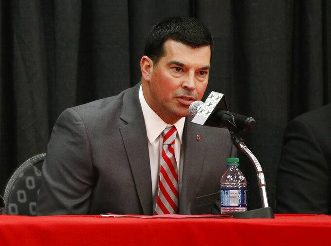 Ohio State NCAA college football offensive coordinator Ryan Day answers questions during a news conference announcing his hiring as head coach to replace Urban Meyer, who announced his retirement Tuesday, Dec. 4, 2018, in Columbus, Ohio. (AP Photo/Jay LaPrete)