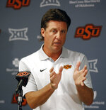 """FILE - In this Aug. 24, 2018, file photo, Oklahoma State head coach Mike Gundy talks with the media during an NCAA college football news conference in Stillwater, Okla. College football recruiting fans used to treat the first Wednesday of February like a virtual national holiday. Now that date's been pushed into the background, likely for good.""""I just think everybody sees (December) as the new signing date, in my opinion,"""" Oklahoma State coach Mike Gundy said. (AP Photo/Sue Ogrocki, File)"""