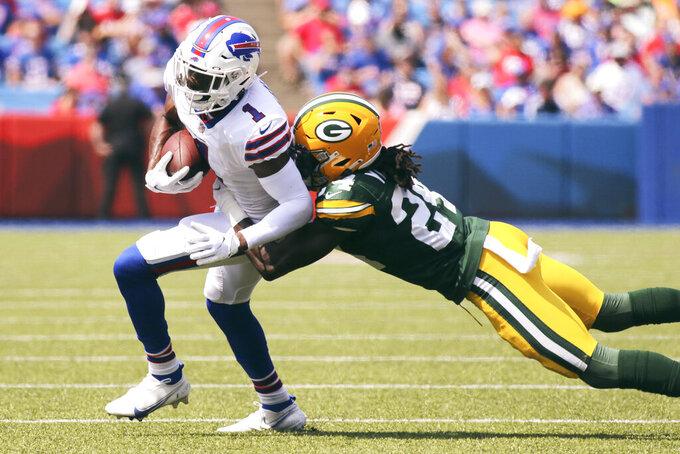 Buffalo Bills wide receiver Emmanuel Sanders (1) tries to break free of Green Bay Packers cornerback Isaac Yiadom (24) during the first half of a preseason NFL football game, Saturday, Aug. 28, 2021, in Orchard Park, N.Y. (AP Photo/Jeffrey T. Barnes)
