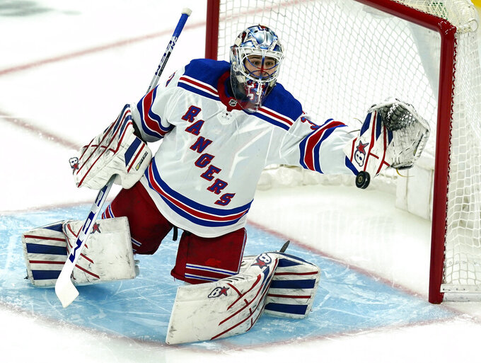 FILE - In this May 6, 2021, file photo, New York Rangers goaltender Igor Shesterkin watches the puck go wide in the first period of an NHL hockey game against the Boston Bruins in Boston. The Rangers secured their goaltending future by agreeing to re-sign Shesterkin to a four-year contract on Monday, Aug. 9, 2021. (AP Photo/Elise Amendola, File)