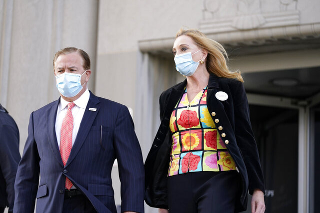 FILE - In this Oct. 14, 2020, file photo, Mark and Patricia McCloskey leave following a court hearing, in St. Louis. A Missouri appellate court Friday, Jan. 8, 2021, denied Circuit Attorney Kimberly M. Gardner's appeal of her and her office's disqualification from the gun case against Mark McCloskey, who with his wife pointed firearms at protesters outside their Central West End home in June. (AP Photo/Jeff Roberson, File)