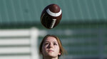 Sam Gordon catches a football, Oct. 20, 2020, in Herriman, Utah. Gordon was the only girl in a tackle football league when she started playing the game at age 9. Now, Gordon hopes she can give girls a chance to play on female-only high school teams through a lawsuit. (AP Photo/Rick Bowmer)