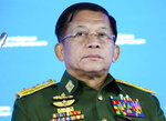FILE - In this June 23, 2021, file photo, Commander-in-Chief of Myanmar's armed forces, Senior General Min Aung Hlaing delivers his speech at the IX Moscow conference on international security in Moscow, Russia. Six months after seizing power from the elected government, Myanmar's military leader on Sunday, Aug. 1, 2021, repeated his pledge to hold fresh elections in two years and cooperate with Southeast Asian nations on finding a political solution for his country. (AP Photo/Alexander Zemlianichenko, Pool)