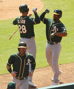 Oakland Athletics Matt Olson (28) bumps elbows with Marcus Semien (10) after his two-run home run against the Texas Rangers in the third inning in a baseball game Sunday, Sept. 15, 2019, in Arlington, Texas. (AP Photo/Richard W. Rodriguez)