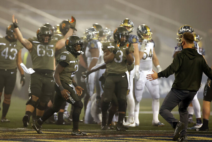 Army quarterback Tyhier Tyler celebrates after defeating Navy in an NCAA college football game Saturday, Dec. 12, 2020, in West Point, N.Y.  (AP Photo/Adam Hunger)