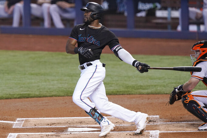 Miami Marlins' Starling Marte grounds into a force out during the first inning of the team's baseball game against the San Francisco Giants, Saturday, April 17, 2021, in Miami. (AP Photo/Marta Lavandier)