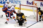 New York Islanders' Brock Nelson (29) puts the game-winning overtime goal behind Pittsburgh Penguins goaltender Matt Murray (30) during an NHL hockey game in Pittsburgh, Tuesday, Nov. 19, 2019. The Islanders won 5-4. (AP Photo/Gene J. Puskar)