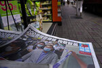 Copies of Apple Daily newspaper with front pages featuring Hong Kong media tycoon Jimmy Lai, are displayed for sale at a newsstand in Hong Kong, Tuesday, Aug. 11, 2020. Hong Kong police arrested Lai and raided the publisher's headquarters Monday, broadening their enforcement of a new security law and raising fears about press freedom in the semi-autonomous Chinese city. (AP Photo/Vincent Yu)