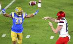 UCLA linebacker Bo Calvert pressures Arizona quarterback Will Plummer during the first half of an NCAA college football game Saturday, Nov. 28, 2020, in Pasadena, Calif. (Keith Birmingham/The Orange County Register via AP)