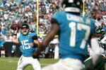 Jacksonville Jaguars quarterback Gardner Minshew II (15) throws a pass to wide receiver D.J. Chark (17) for a touchdown against the New York Jets during the second half of an NFL football game, Sunday, Oct. 27, 2019, in Jacksonville, Fla. (AP Photo/Stephen B. Morton)