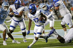 Georgia State running back Destin Coates (17) tries to get past North Carolina linebacker Cedric Gray (33) during the first half of an NCAA college football game against North Carolina in Chapel Hill, N.C., Saturday, Sept. 11, 2021. (AP Photo/Chris Seward)