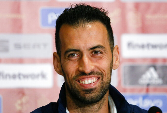 Spain's Sergio Busquets attends a press conference at the Olimpiyskiy Stadium in Kyiv, Ukraine, Monday, Oct. 12, 2020. Ukraine will play a UEFA Nations League soccer match against Spain on Tuesday. (AP Photo/Efrem Lukatsky)
