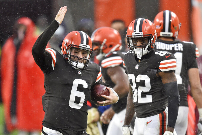 Cleveland Browns quarterback Baker Mayfield (6) signals a first down during the second half of an NFL football game against the Philadelphia Eagles, Sunday, Nov. 22, 2020, in Cleveland. (AP Photo/David Richard)