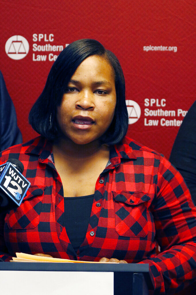 FILE - In this May 23, 2017, file photograph, Dorothy Haymer, of Yazoo City, speaks during a news conference, in Jackson, Miss. Haymer, an African American mother with children in public elementary school, is a plaintiff in a lawsuit filed on their behalf by the Southern Poverty Law Center. The U.S. Supreme Court said Thursday, April 8, 2021, that it will not get involved, for now, in the lawsuit that says the State of Mississippi allows grave disparities in funding between predominantly Black and predominantly white schools. (AP Photo/Rogelio V. Solis, File)