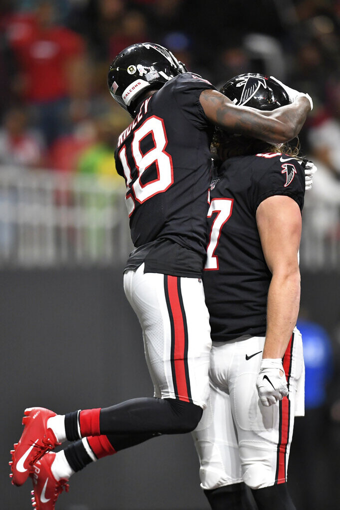 Atlanta Falcons wide receiver Calvin Ridley (18) celebrates the touchdown of Atlanta Falcons tight end Jaeden Graham (87) against the New Orleans Saints during the first half of an NFL football game, Thursday, Nov. 28, 2019, in Atlanta. (AP Photo/Danny Karnik)