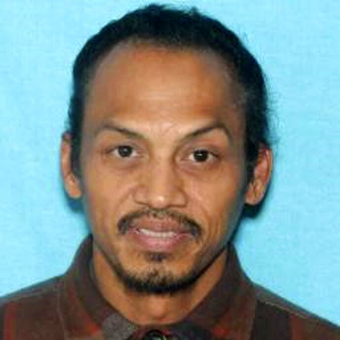 This undated booking photo provided by the Idaho State Police shows Jonathan Llana.  A search was underway Thursday, May 23, 2019, in southern Idaho for Llana, suspected of shooting and killing a motorist on a Utah highway, Idaho State Police said in a statement. (Idaho State Police via AP)