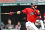 Cleveland Indians' Carlos Santana hits into a fielders choice in the first inning in a baseball game against the Minnesota Twins, Sunday, Sept. 15, 2019, in Cleveland. Santana was safe at first base. Francisco Lindor scored on the play. (AP Photo/Tony Dejak)