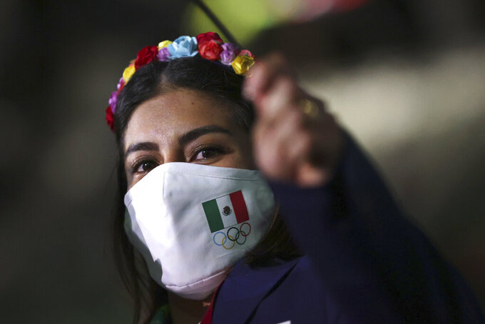 A member from Team Mexico arrives during the opening ceremony in the Olympic Stadium at the 2020 Summer Olympics, Friday, July 23, 2021, in Tokyo, Japan. (Hannah McKay/Pool Photo via AP)