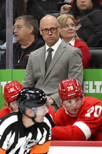 Detroit Red Wings head coach Jeff Blashill, top, watches his team play against the St. Louis Blues in the first period of an NHL hockey game, Sunday, Oct. 27, 2019. (AP Photo/Jose Juarez)