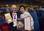 Chemistry laureate Akira Yoshino and his wife Kumiko pose with his Nobel medal and diploma during the Nobel Prize award ceremony at the Stockholm Concert Hall, in Stockholm, Tuesday, Dec. 10, 2019. (Jonas Ekstromer/TT News Agency via AP)