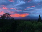 This photo provided by Maui County Council member Yuki Lei Sugimura shows the sunset from her Maui home, Tuesday, Sept. 11, 2018, before Tropical Storm Olivia made landfall.  The storm brought heavy rains to Maui and the Big Island before it was expected to move on to Oahu. (Photos by Yuki Lei Sugimura via AP)