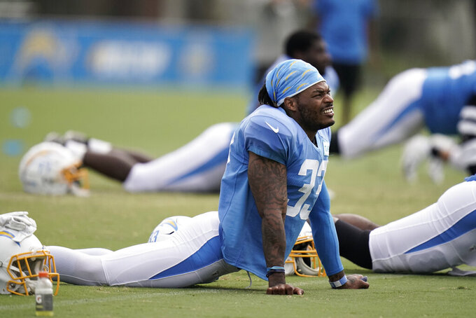 Los Angeles Chargers safety Derwin James stretches during an NFL football camp practice, Monday, Aug. 17, 2020, in Costa Mesa, Calif. (AP Photo/Jae C. Hong)