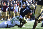 Navy quarterback Tai Lavatai (1) is sacked by Marshall defensive lineman TJ Johnson (15) during the first half of an NCAA college football game, Saturday, Sept. 4, 2021, Annapolis, Md. (AP Photo/Terrance Williams)