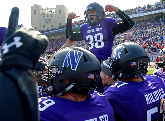 Northwestern's Drew Luckenbaugh (38) celebrates his game-winning field goal in overtime against Nebraska in an NCAA college football game Saturday, Oct. 13, 2018, in Evanston, Ill.. (AP Photo/Jim Young)